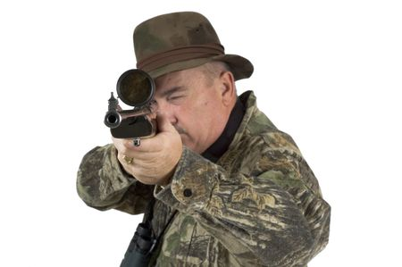 Man in camouflage clothing with rifle taking aim at target on a white background