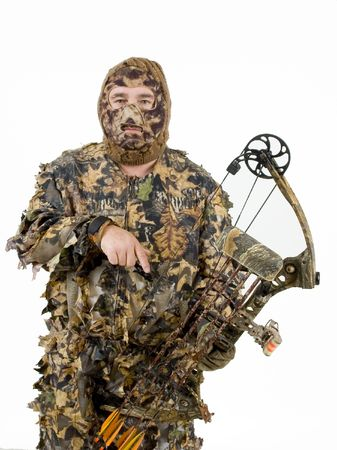 Bowhunter in full camo photo