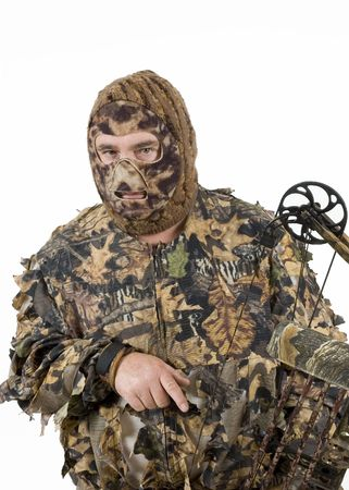 finger on trigger: Bowhunter in lightweight full 3D camouflage with modern compound bow
