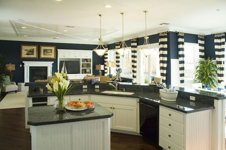Modern kitchen with two islands adjoining family room and dining area in a California home