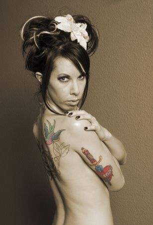 the  then: Pretty girl with tattoos on back in sepia, layered then erased so that eyes, stamen and tattoos are in color