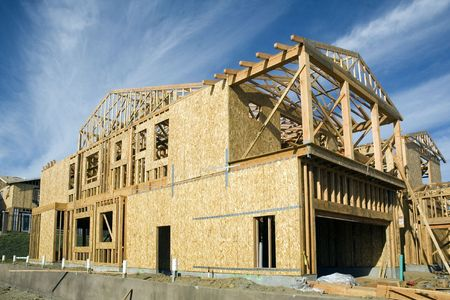 rafters: Construction jobsite with house under construction showing framing stage with some shear on the walls