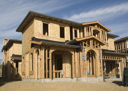 Construction jobsite with house under construction showing framing stage with some shear on the walls photo