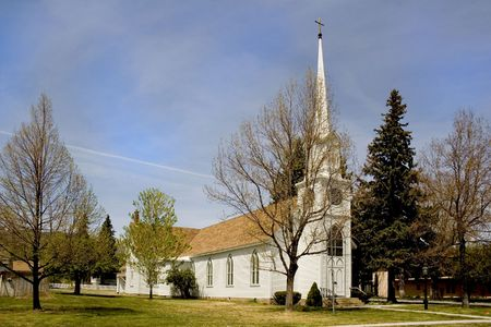 small cute white church in Carson City,  Nevada with steeple Stock Photo