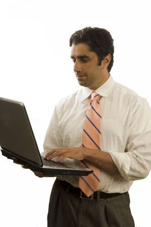 Young happy Iranian businessman using laptop computer - isolated photo