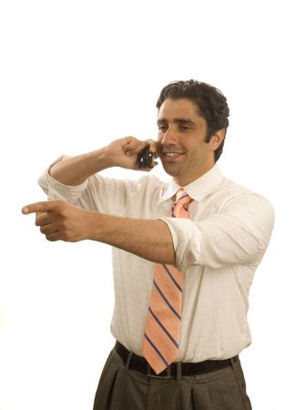 Young happy businessman on cell phone, and pointing - isolated photo