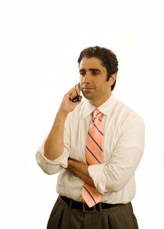 Young serious businessman on cell phone isolated