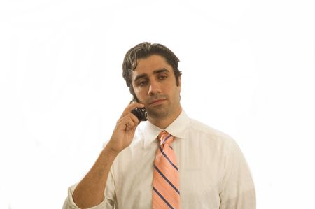 Young serious businessman on cell phone isolated Stock Photo - 930802