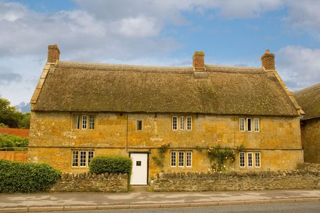 Cottage in the village of Chideock in Dorset, England photo