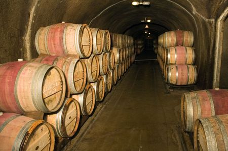 corked: Wine barrels in a storage cave at a winery in Napa Valley