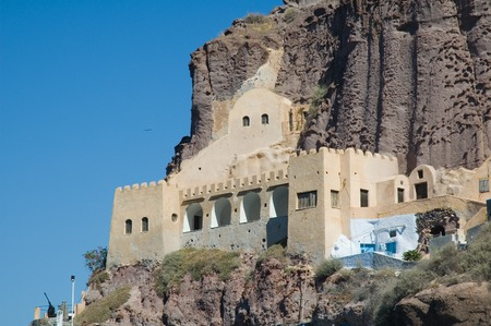 Coast gurd station on the volcanic Greek island of Santorini, constructed into the side of the cliff of the Caldera