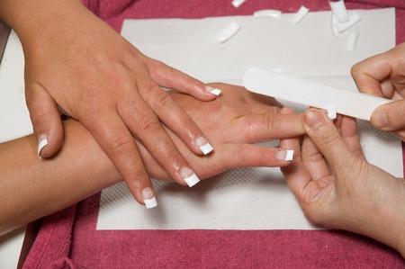manicurist: Manicurist shaping fake nails