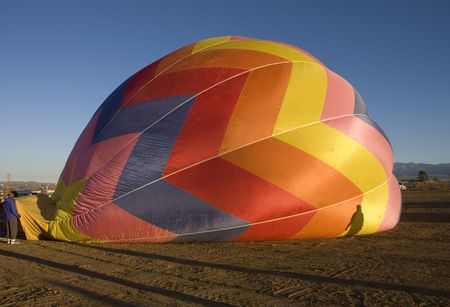 inflating: One of the many balloons at the Taos balloon festival being inflated at dawn Stock Photo