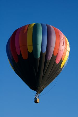 One of the many balloons at the Taos balloon festival being inflated at dawn Фото со стока