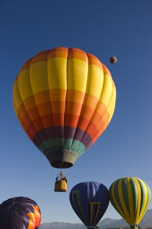 inflating: One of the many balloons at the Taos balloon festival rising in the cold morning air