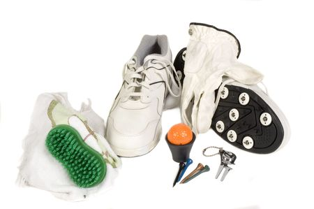 fixer: Group of golf accesories including shoes, with metal spikes, towel, brush, ball retriever, divit fixer, ball, tees, glove and ball marker