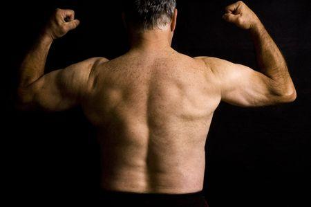 deltoids: A 60 year old man flexing muscles