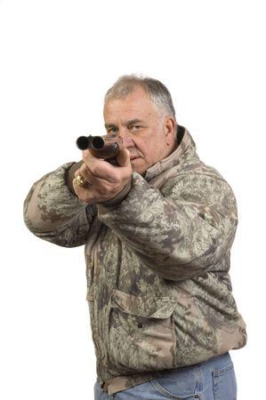 hombre disparando: El hombre disparando a meta con un doble ca��n al lado de la otra escopeta calibre 20