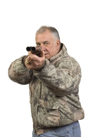 Man shooting at target with a double barrelled side by side 20 gauge shotgun Stock Photo