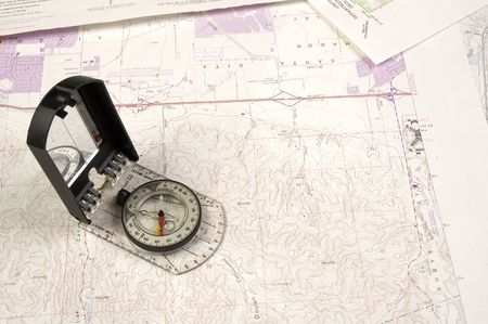 topographical: Topographical map and compass