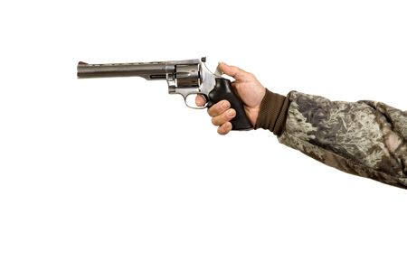 backstop: Man shooting at target with a cocked revolver Stock Photo