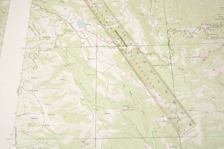 topographical: Topographical map and ruler used to determine position on map, using 30mm scale between longitudinal 2.5 minute sections of map Stock Photo