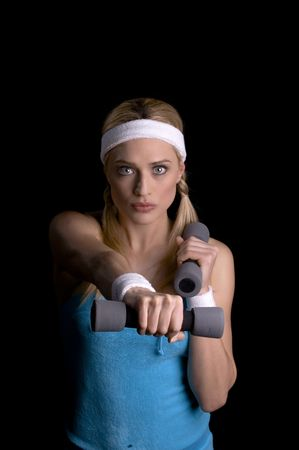 cardiovascular exercising: Woman doing exercise with weights over a black background Stock Photo