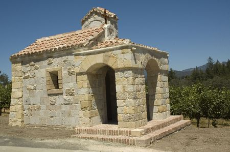 viticulture: Copy of a Medieval Tuscan chapel in a terraced vineyard in the hills of Northern California