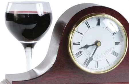 shiney: mantle clock and a glass of wine symbolising time for a drink