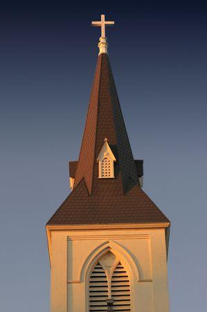 Golden glow of the setting sun on a church steeple in Santa Cruz, California