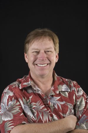 unshaven middle aged man in floral shirt man isolated on black