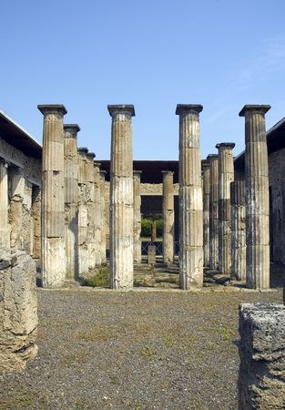 Roman ruins in Pompeii with columns that supported a temple Stock Photo - 2583228
