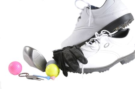 fixer: Group of golf accesories including shoes, with metal spikes, ball retriever, divit fixer, ball, tees, glove and ball marker Stock Photo