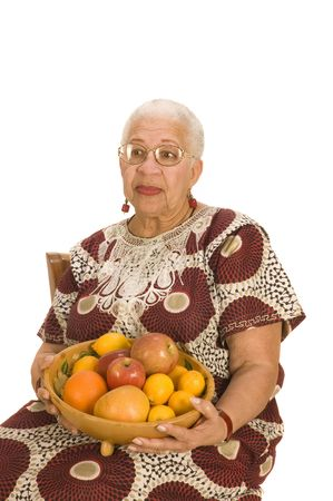 Attractive Elderly African American Woman isolated on white with a fruit bowl Stock Photo - 2656504