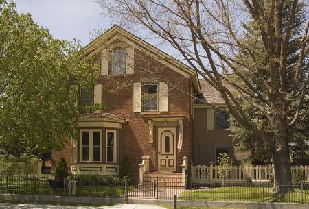 stoop: Older Victorian  or Georgian style home in Nevada, with Bay window and stoop