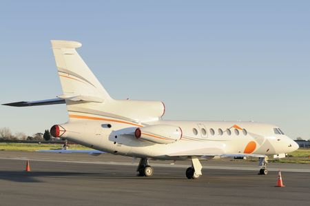 aileron: Private jet aircraft parked on the tarmac