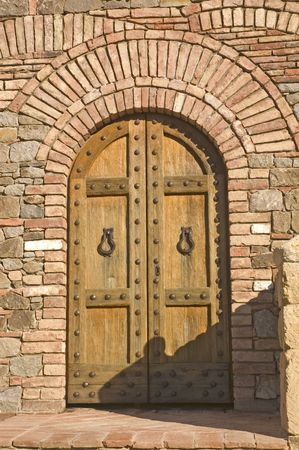 arched: Castle door on medieval Tuscan fortification