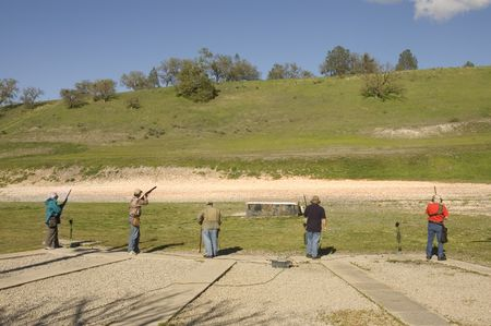 squad: squad of trap shooters practicing Stock Photo