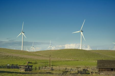 bard: Wind generators in a rural setting with barn, water pump and sheep