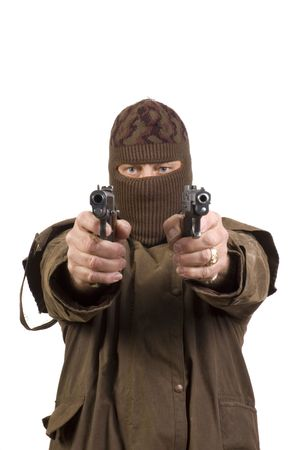Masked man with two semi-automatic pistols pointed at the camera and isolated on white