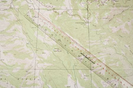 topographical: Topographical map and ruler used to determine position