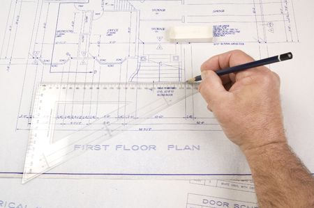 architect drawing: Architect changing drawing of plans for a house Stock Photo