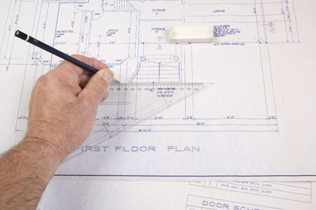 Architect changing drawing of plans for a house Stock Photo - 2805923