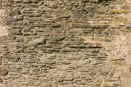 old castle stone masonry wall as a background