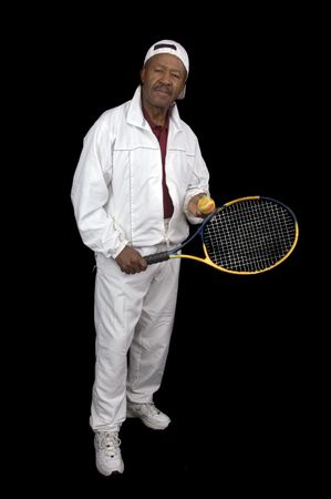 sweatsuit: African American active senior citizen tennis player isolated over black background Stock Photo