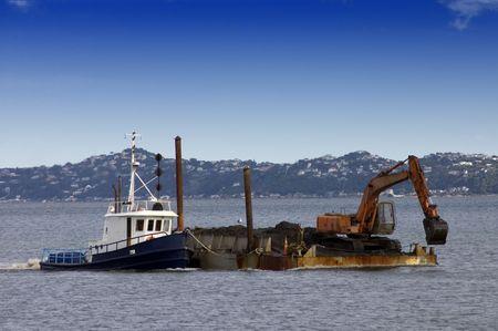 dredging: Tug boat pushing dredging barge Stock Photo