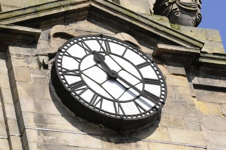 Old church clock in Inverness, Scotland at 11:25 in the morning