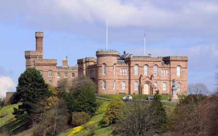 Hilltop Castle on embankment above the Rivar Ness at Inverness in Scotland Stock Photo
