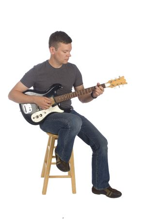 fingering: Guitarist playing while isolated on white
