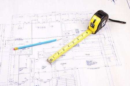 Set of building plans for a custom house with tape measure and pencil Archivio Fotografico